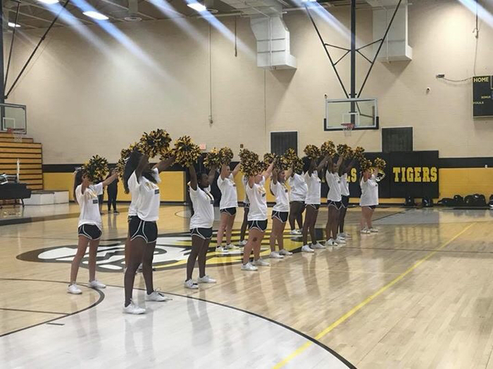 Cheerleaders lead the call for the Tigers!