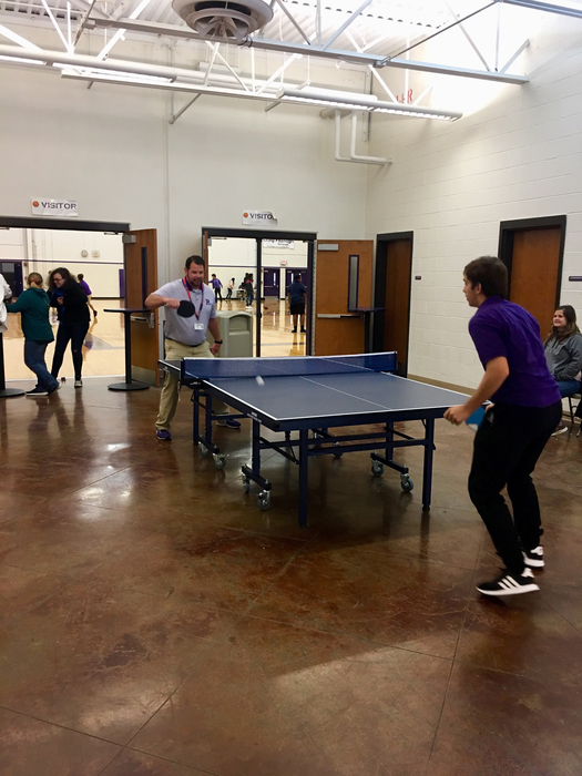 Mr. Byrd, RHS Principal, challenging a student to a game of ping pong.