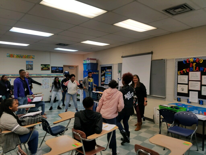 Students playing Simon Says in Spanish 1 to hell master their language skills.