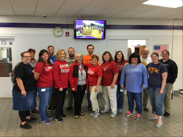 Teachers got to wear their shirts from their colleges.