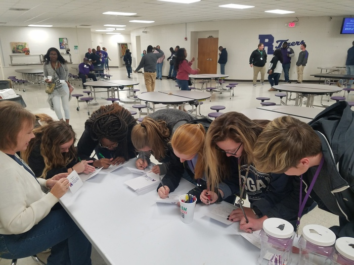 Students signed thank you notes to send to deployed soldiers in honor of Veteran's Dat and Thanksgiving.
