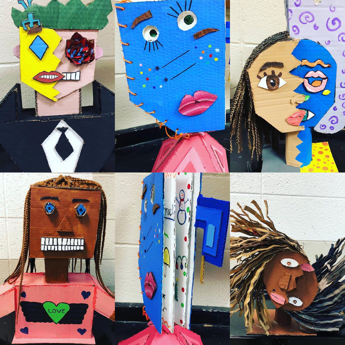 Mr. Harmon's 3D class just finished cubistic self portraits from card board.They did a great job!