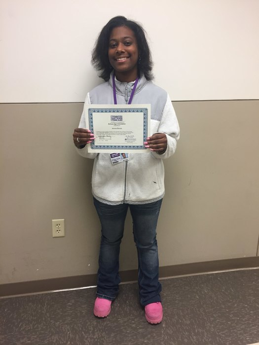 Ahmia Bonds receives her certificate for completing the School-Age Orientation through the Tennessee Early Childhood Training Alliance.