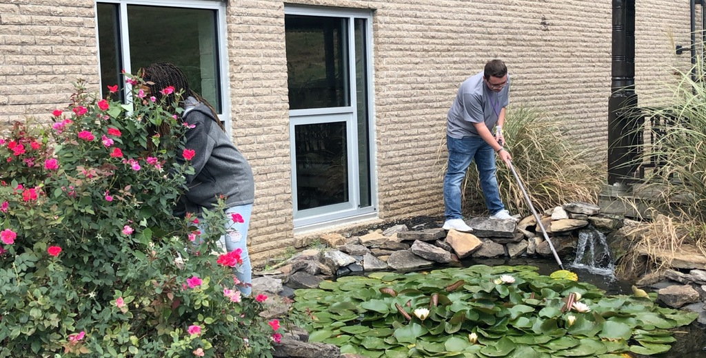 Mrs. Coulston's class worked hard to finish up maintenance on the water garden before the fall season arrives.